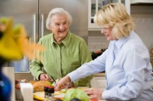 younger and older women cooking